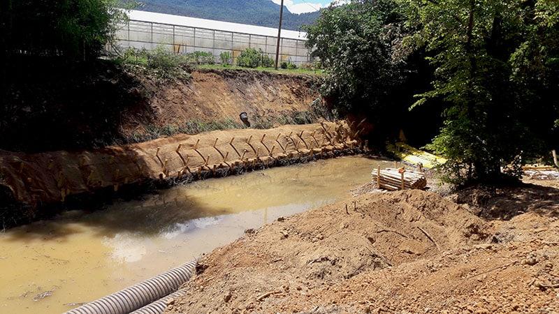 Travaux de protection de berge après travaux sous-fluviaux